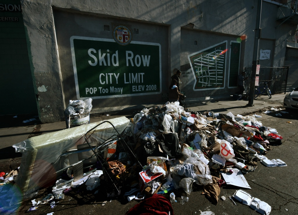 Trash lies beside the Skid Row City Limit mural as the city begins its annual homeless count in Los Angeles, California on January 26, 2018. Thousnads of volunteers will fan out across Los Angeles County during the three-night count of homeless people whose population is estimated to be nearly 60,000 strong.  / AFP PHOTO / Mark RALSTON        (Photo credit should read MARK RALSTON/AFP/Getty Images)