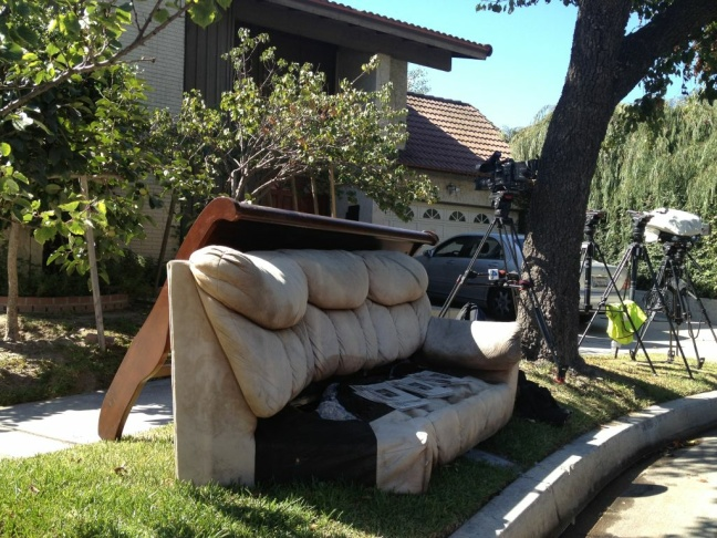 A discarded couch and headboard at the curb in front of the Nakoula residence in Cerritos