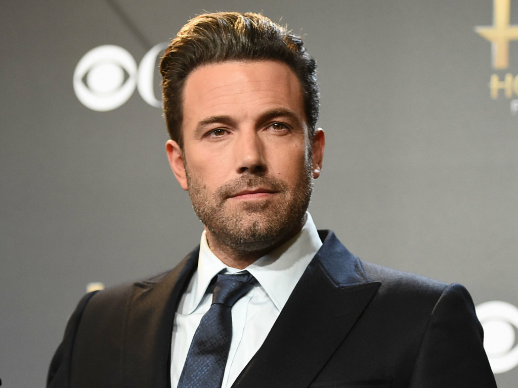 Ben Affleck poses in the press room with the Hollywood film award for
