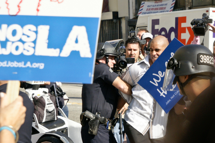 A protester is arrested by Los Angeles Police Department (LAPD) officers after he attempted to join a group of Occupy LA demonstrators who were occupying a park in front of the Bank of America building on Nov. 17, 2011 in downtown Los Angeles. Several dozen Occupy LA demonstrators were arrested by the LAPD after marching through downtown. The protest was part of a 'Day of Action' marking the two-month anniversary of the movement that started in New York as Occupy Wall Street.