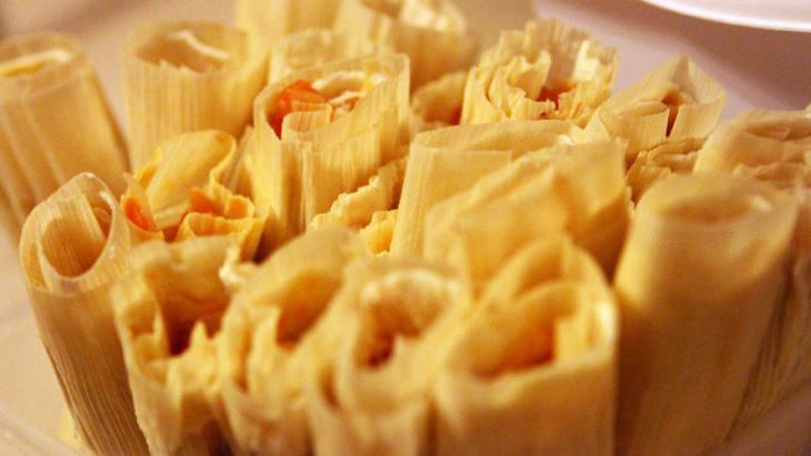Ofelio Crespo makes tamales in his home on Dec. 20.