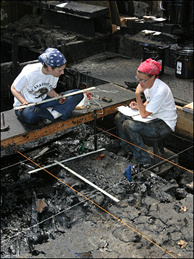 Excavators Kristen Vowels and Samantha Green looking for fossils at Pit 91 at the La Brea Tar Pits.