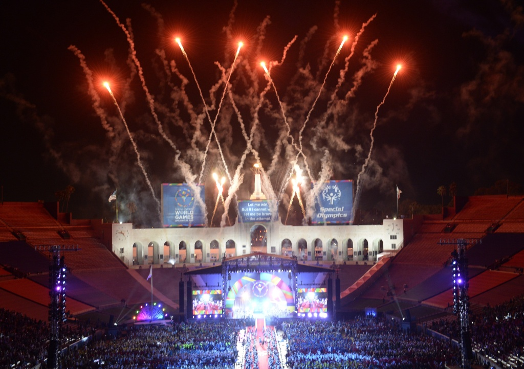 File: Fireworks explode over the Los Angeles Memorial Coliseum during the 2015 Special Olympics World Games Opening Ceremony, July 25, 2015 in Los Angeles,.