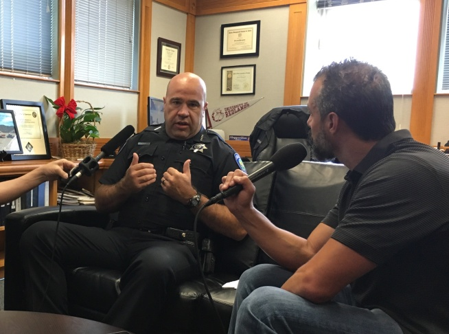 Chief Jarrod Burguan talks to A Martinez