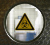 A biohazard sign is pictured on an entrance door for analysis for H1N1 virus