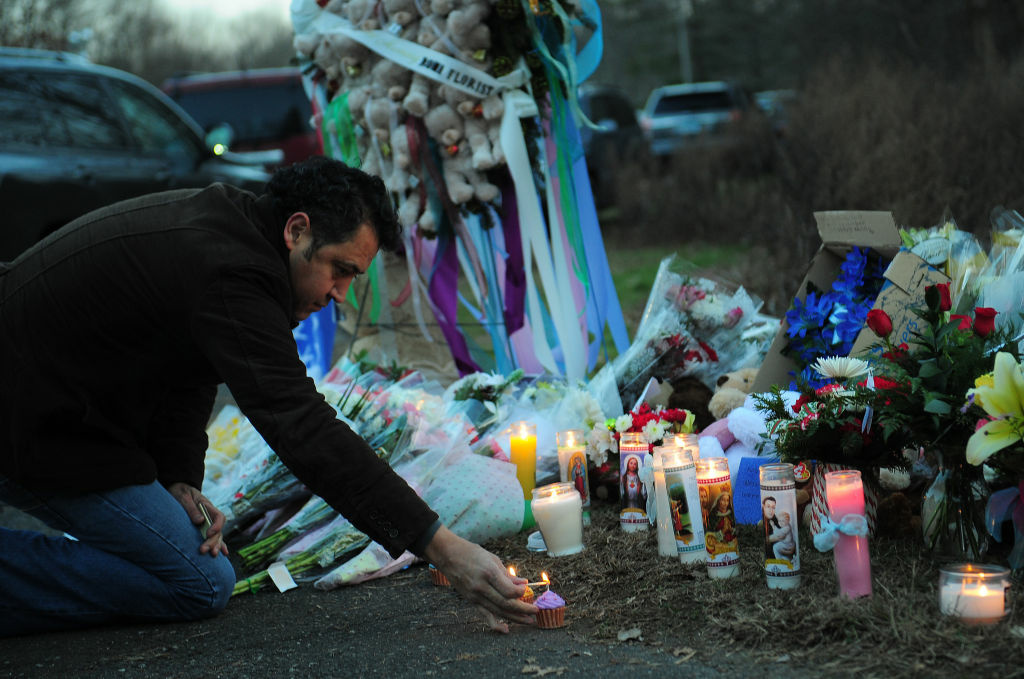 A man pays tribute to the victims of an elementary school shooting in Newtown, Connecticut.