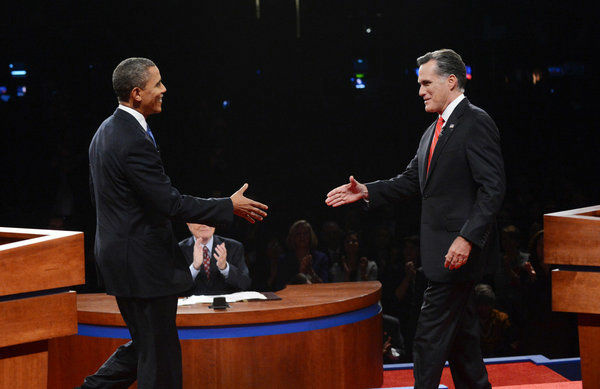 U.S. President Barack Obama (L) shakes hands with Republican presidential candidate and former Massachusetts Gov. Mitt Romney during the Presidential Debate at the University of Denver on October 3, 2012 in Denver, Colorado.