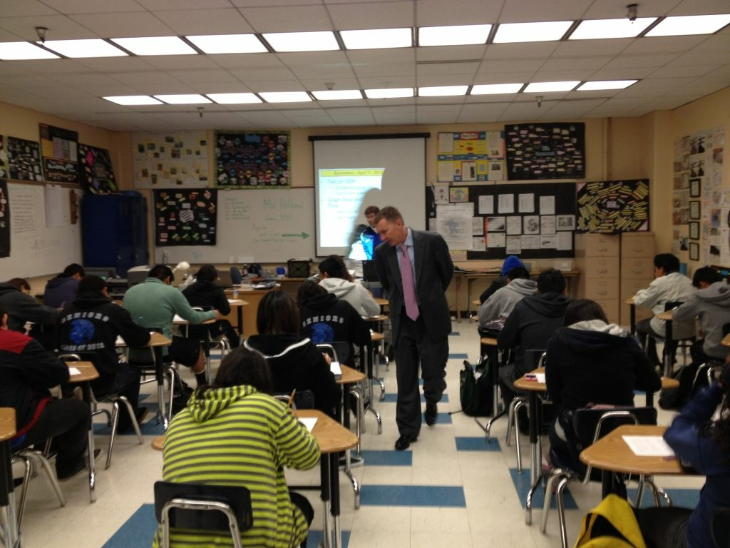 Superintendent John Deasy walks through an economics classroom at Los Angeles High School during a surprise visit.