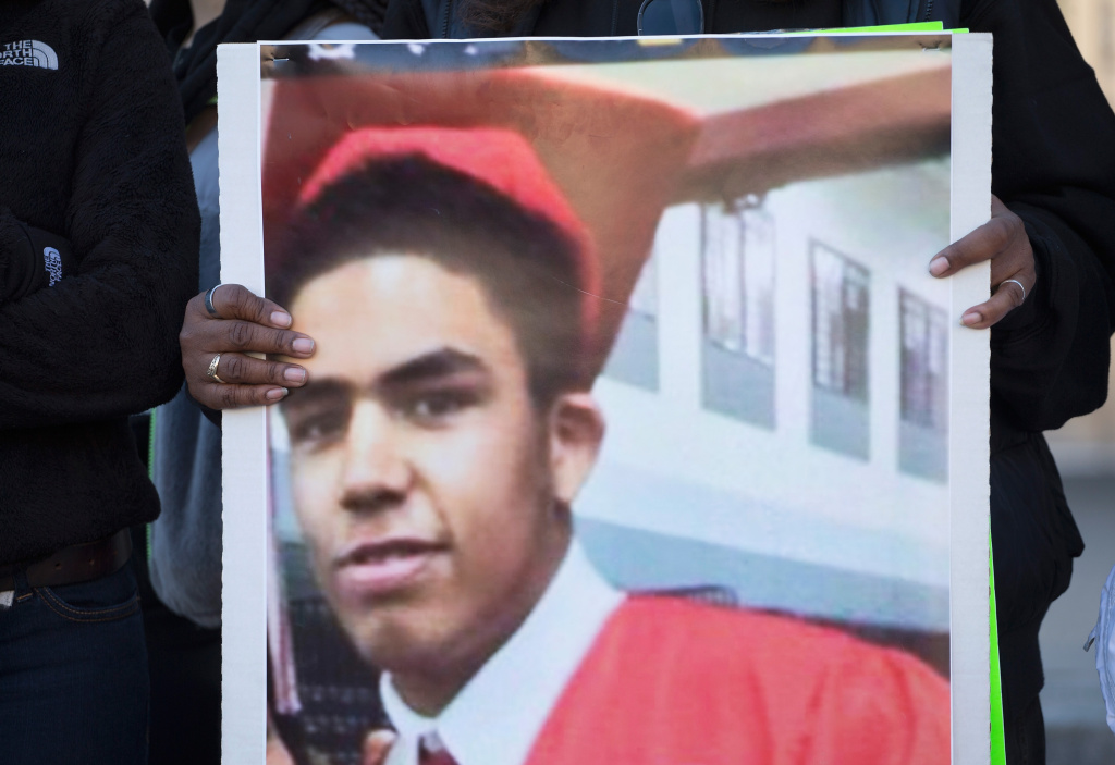A family member holds a picture of Tony Robinson during a protest outside of the City Hall building on March 9, 2015 in Madison, Wisconsin. The police officer who killed the unarmed teen will not be charged with a crime in the shooting, a prosecutor announced Tuesday.