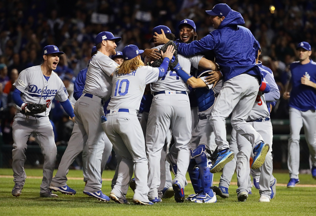 The Los Angeles Dodgers celebrate defeating the Chicago Cubs 11-1 in game five of the National League Championship Series at Wrigley Field on October 19, 2017 in Chicago, Illinois.