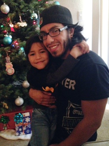 Manny Cardenas, seen here with his 5-year-old daughter Zoe, has earned $16 an hour as a part-time security guard at Google.