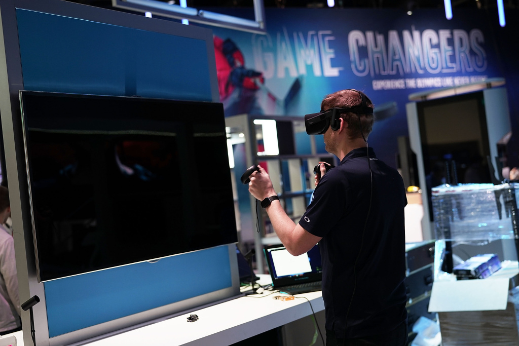 A member of a show crew sets up exhibition for the booth of Intel prior to the CES 2018 at the Las Vegas convention Center on January 6, 2018 in Las Vegas, Nevada.