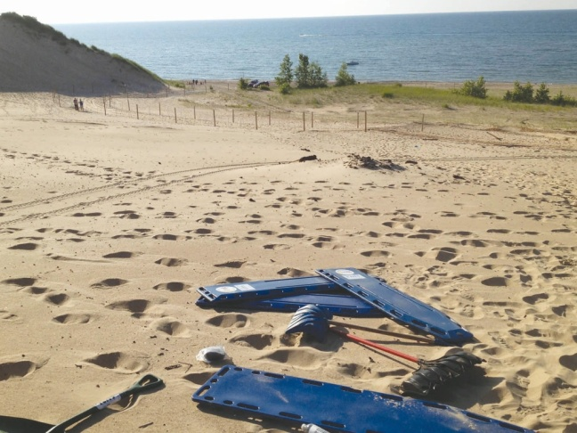 Rescue gear sits on the sand on Mount Baldy in the Indiana Dunes in July, 2013, after a 6-year-old boy was rescued from a mysterious hole that buried him for three hours. Lake Michigan is in the background.
