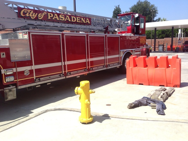 Pasadena resident Tao Kwan flips through her training book at the Pasadena Fire Department's emergency response training. Kwan was one of 24 people who attended Saturday's session.