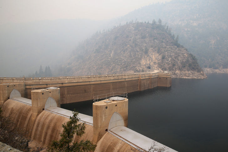 Smoke from the Rim Fire lingers over the O'Shaughnessy Dam at Hetch Hetchy Reservoir on August 24, 2013 in Yosemite National Park, California. The Rim Fire continues to burn out of control and threatens 4,500 homes outside of Yosemite National Park. Over 2,000 firefighters are battling the blaze that has entered a section of Yosemite National Park and has prompted California Gov. Jerry Brown to declare a state of emergency for San Francisco due to damage to some of the lines and stations that move power to San Francisco. The Hetch Hetchy reservoir also had to take two of its three hydroelectric power stations out of service.