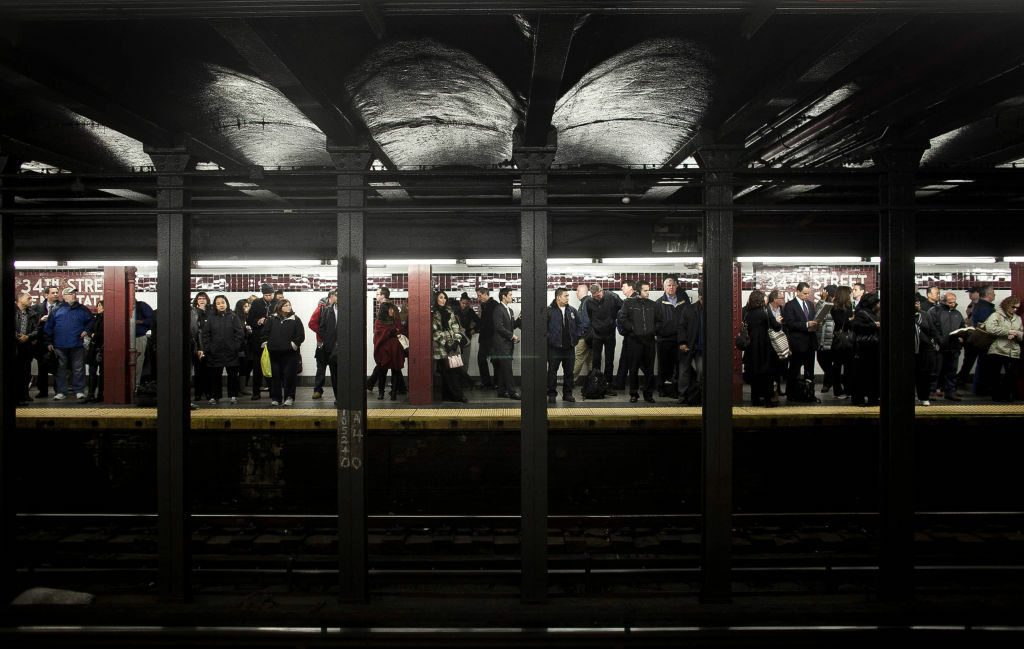 Commuters wait for the A train at Penn Station November 4, 2012 in New York City.