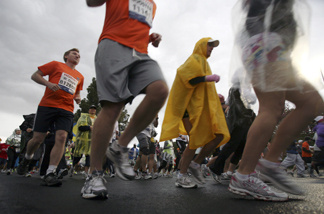 Runners start the Los Angeles Marathon on a stormy Sunday, March 20, 2011.