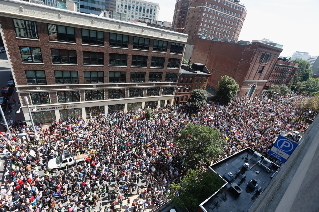 Thousands of counter-protesters march in Boston against a planned
