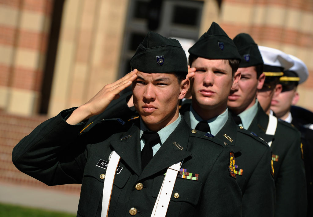 Members of the UCLA NROTC salute during playing of taps during UCLA's annual Veterans Day Memorial Ceremony on November 9, 2011 in L.A.