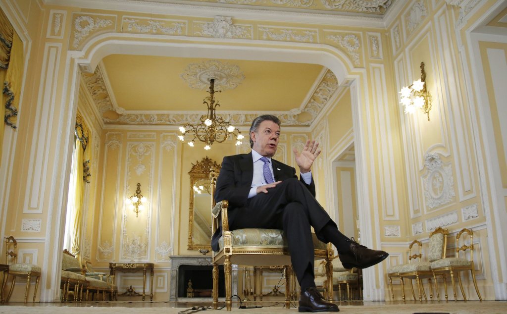 Colombia's President Juan Manuel Santos talks during an interview at the Presidential Palace in Bogota, Colombia, Thursday, Jan. 28, 2016. President Santos is hoping the U.S. will suspend drug warrants against guerrilla commanders and remove the Revolutionary Armed Forces of Colombia from a list of terrorist groups to help cinch a peace deal with Latin America's insurgency. (AP Photo/Fernando Vergara)