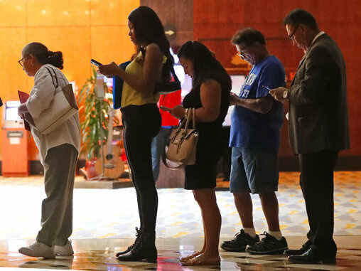 Job applicants wait in line at the Seminole Hard Rock Hotel & Casino Hollywood during a job fair in Hollywood, Fla., on June 4.  When employment data is released Friday morning, economists predict employment gains of about 160,000 jobs in June, after disappointing job growth the month before.