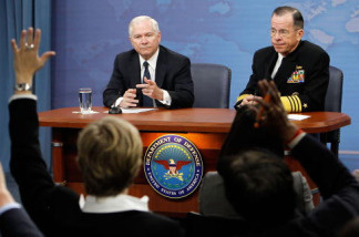 U.S. Secretary of Defense Robert Gates (L) and Chairman of the Joint Chiefs of Staff Admiral Michael Mullen (R) take questions from members of the media during a press briefing at the Pentagon March 25, 2010 in Arlington, Virginia. Gates announced that the Pentagon will ease the enforcement of the 'Don't Ask, Don't Tell' policy.