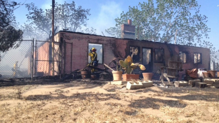 At least one home has burned in the Summit Fire on May 1, 2013.