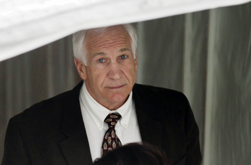 Former Penn State assistant football coach Jerry Sandusky leaves the Centre County Courthouse.