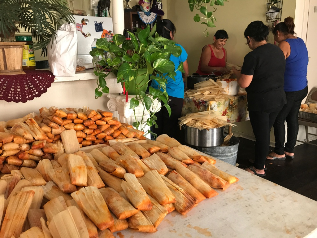 Women in Huntington Beach's Oak View neighborhood prepare nearly 2,000 tamales for attendees of the annual celebration of St. James, known as Santiago in the Spanish-speaking world, July 27, 2017.