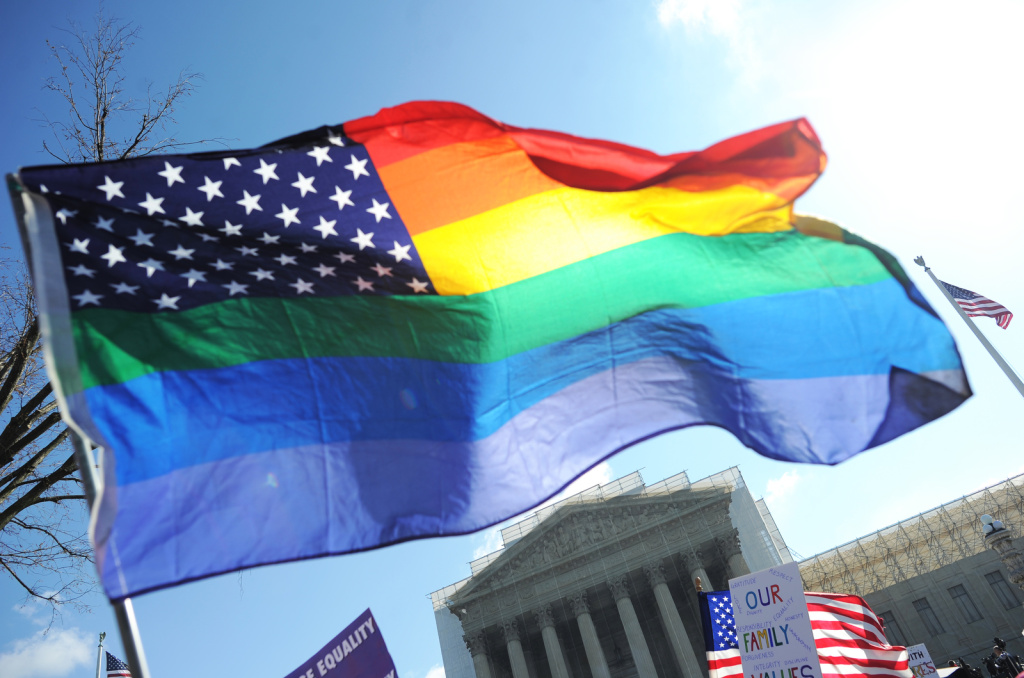 File: Same-sex marriage supporters wave a rainbow flag in front of the U.S. Supreme Court on March 26, 2013 in Washington, D.C.