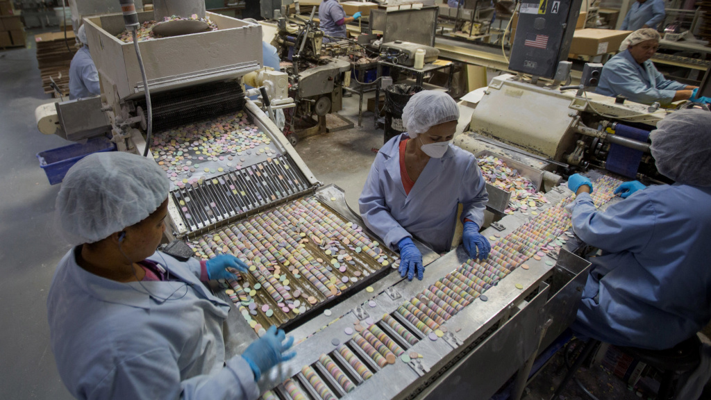 Workers sort NECCO Wafers at the New England Confectionery Co. in Revere, Mass. The Ohio-based Spangler Candy Company made the winning bid for NECCO, which filed for bankruptcy in early April.