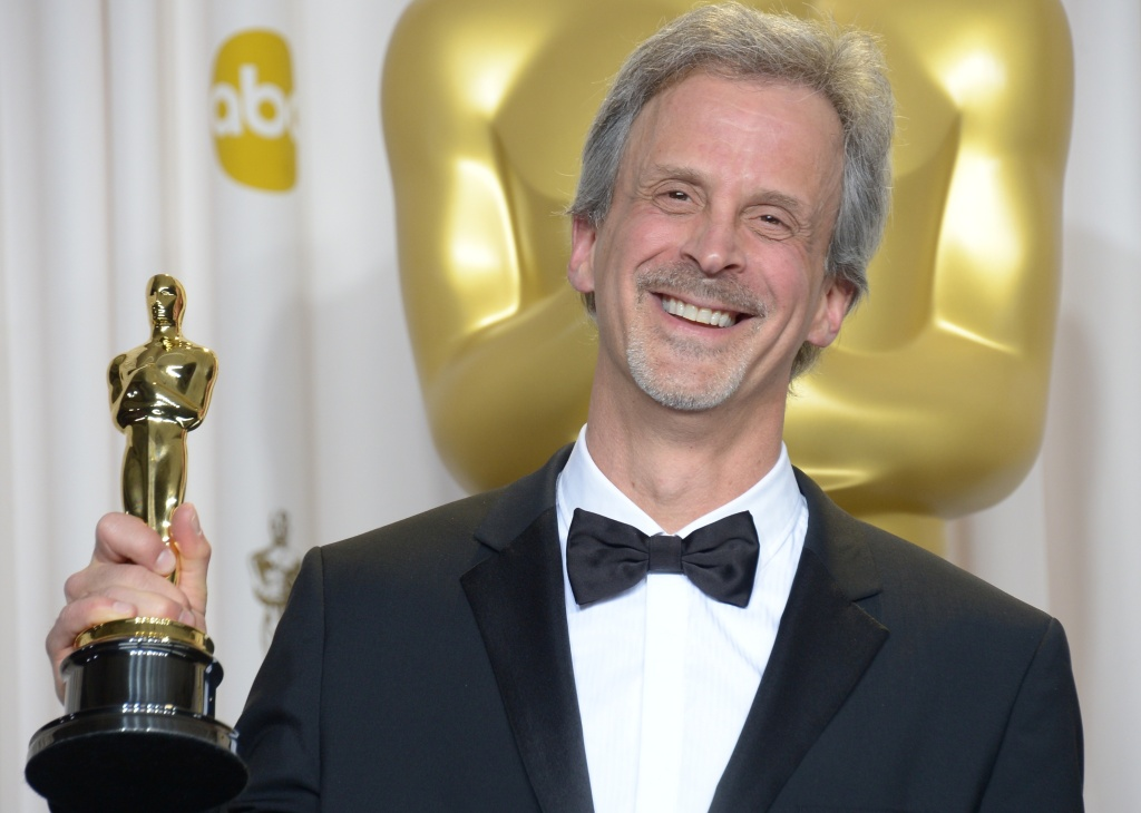 William Goldenberg celebrates winning the Best Film Editing Award for