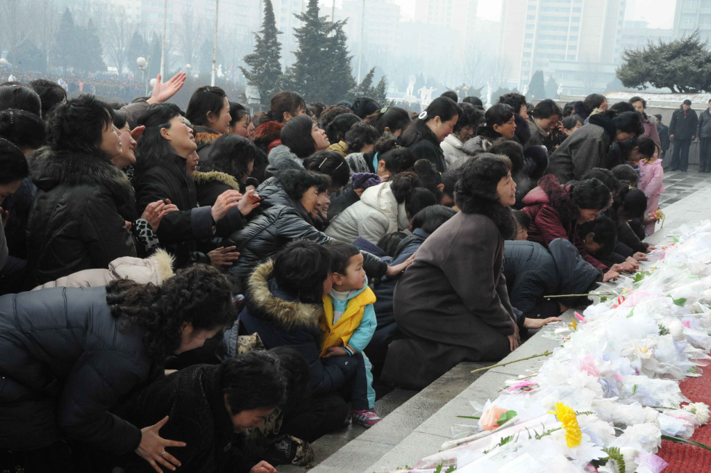 This picture taken on December 21, 2011 shows Pyongyang citizens gathering to mourn the late North Korean leader Kim Jong-il at the Pyongyang Gymnasium.