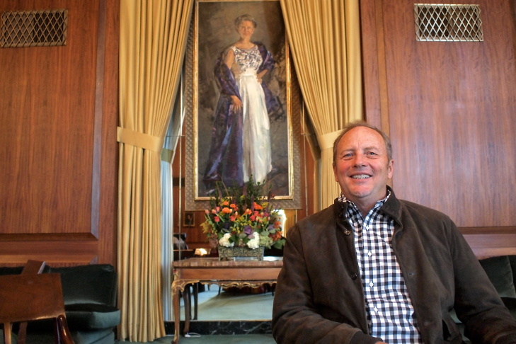 Harry Chandler sits in front of the portrait of his grandmother, philanthropist Dorothy Chandler. The portrait is on display inside the Founder's Room at the Music Center in Downtown LA.