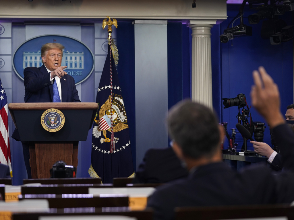 President Trump calls for questions during a news conference at the White House Wednesday.