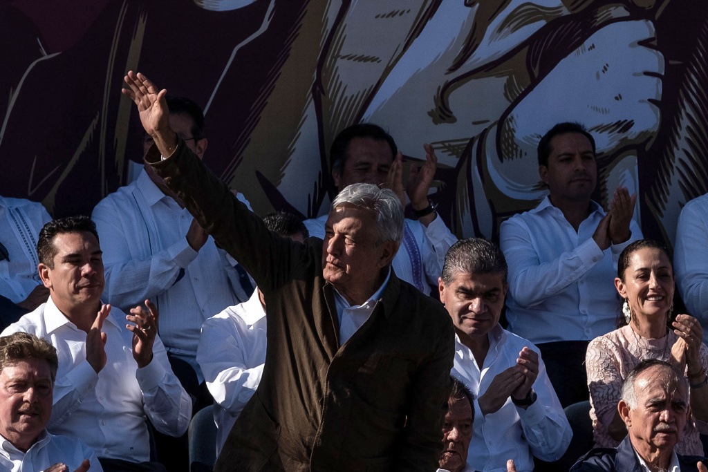 Mexican President Andres Manuel Lopez Obrador waves as he arrives to a rally to 'defend mexican dignity' in Tijuana, Baja California state, Mexico on June 8, 2019.