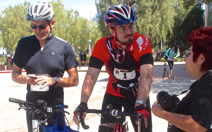 Damian Kevitt (center) at the finish line during the Finish the Ride event.