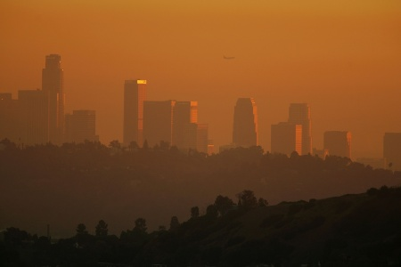 The Trump administration is suing California over its emissions-trading market, which aims to reduce air pollution.