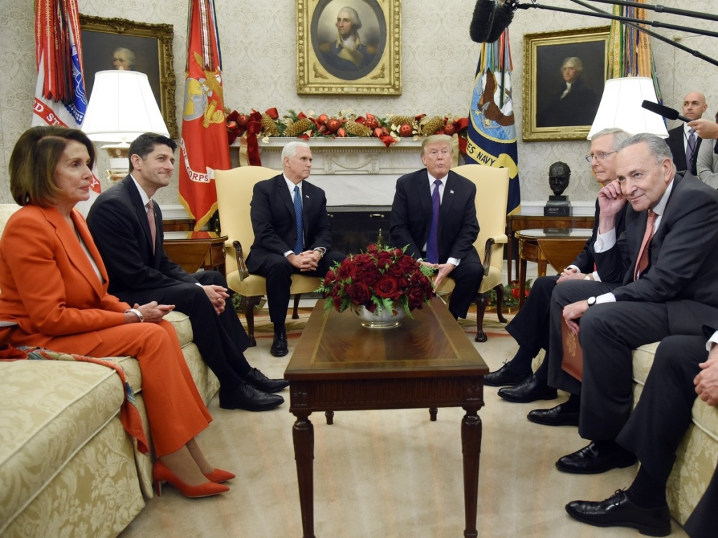 President Trump and Vice President Pence meet with congressional leadership (on couches from left) House Minority Leader Nancy Pelosi, House Speaker Paul Ryan, Senate Majority Leader Mitch McConnell and Senate Minority Leader Chuck Schumer in the Oval Office last December.