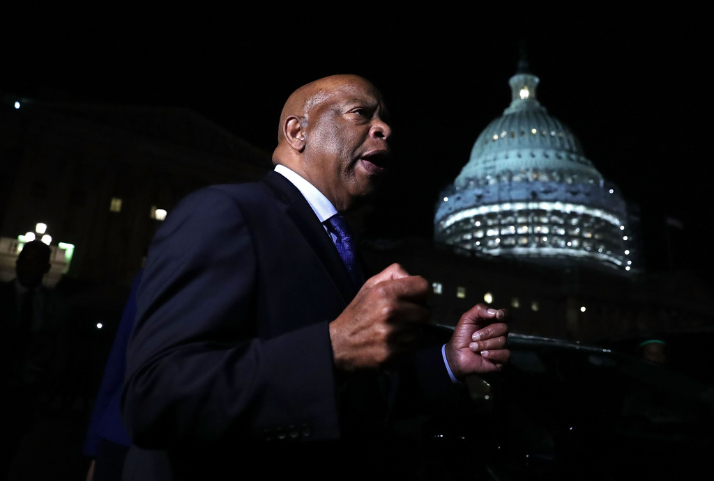 U.S. Rep. John Lewis (D-GA) speaks to gun control activists who gather outside the Capitol as House Democrats stage a sit-in on the House floor June 22, 2016 on Capitol Hill in Washington, DC.