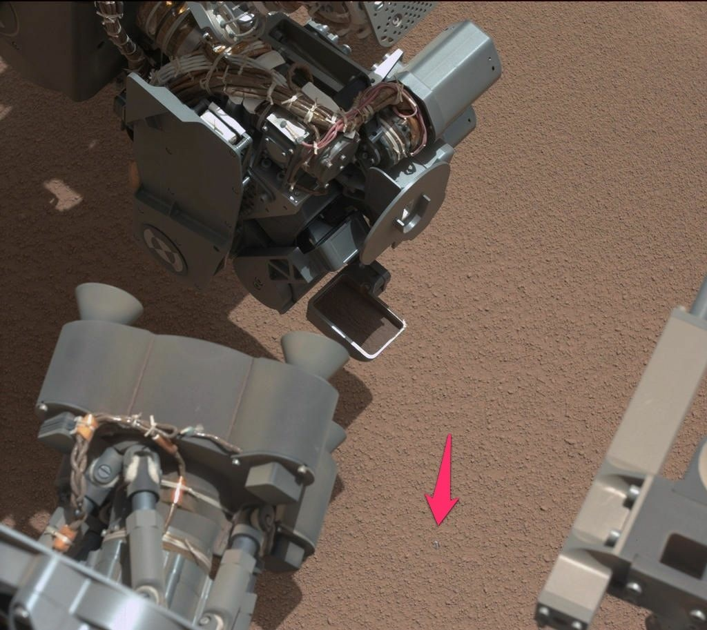 This shiny object on Mars (emphasis added by KPCC) is likely a piece of the Curiosity rover that came loose during entry, descent or landing, according to NASA.
