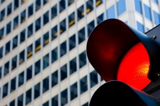A traffic signal shows red.