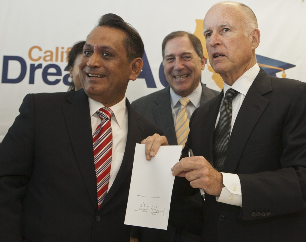 Gov. Jerry Brown, right, endorsed Gil Cedillo, left,  Tuesday for the Los Angeles City Council's First District. He faces two opponents in the March 5 primary.