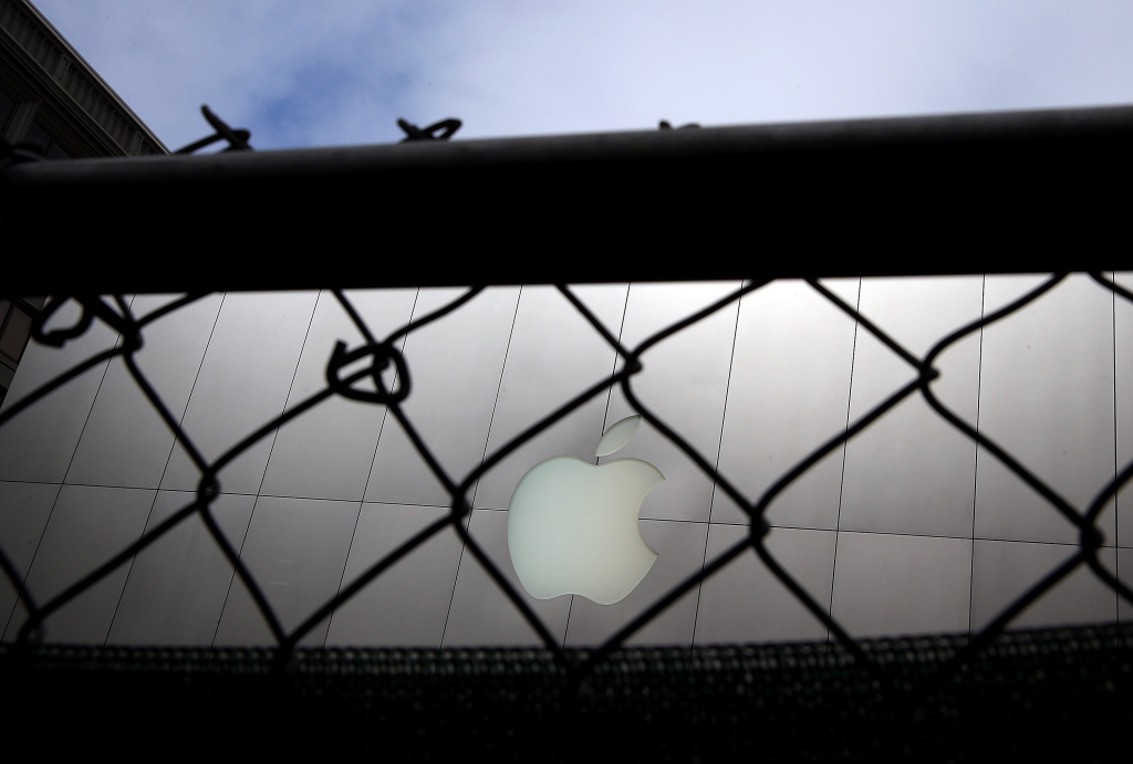 The Apple logo is seen through a fence in front of an Apple Store on July 10, 2013 in San Francisco, California.