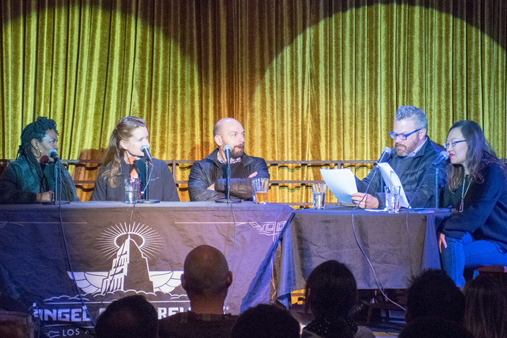 Three panelist participate in a live taping of the podcast