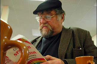 Off-Ramp literary commentator Marc Haefele, who is also an Argentinaphile, studies up during breakfast at Philippe's.