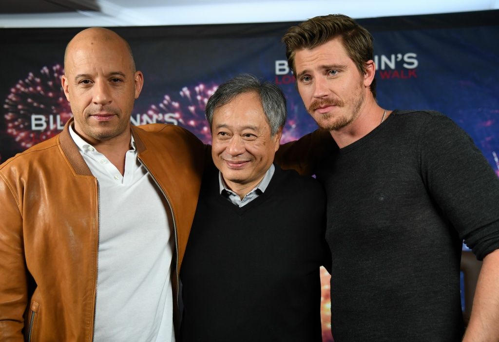 Actors Vin Diesel (L) and Garrett Hedlund with director Ang Lee (C) attend the