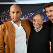"""Actors Vin Diesel (L) and Garrett Hedlund with director Ang Lee (C) attend the """"Billy Lynn's Long Halftime Walk"""" photo call on October 15, 2016 in New York City."""