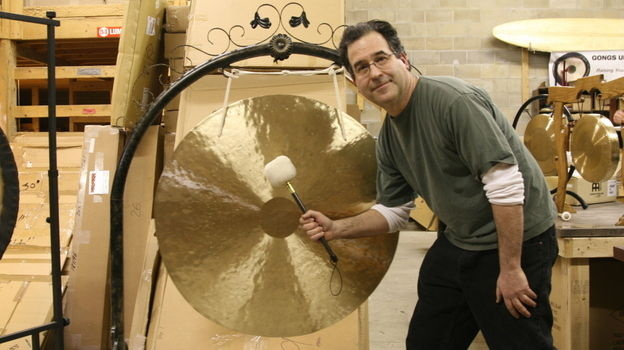 Andrew Borakove with one of his many gongs for sale.