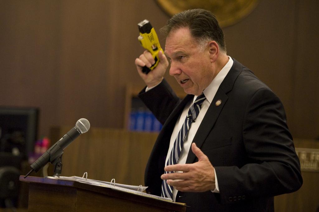 Orange County district attorney Tony Rackauckas displays a Taser stun gun during his closing arguments.